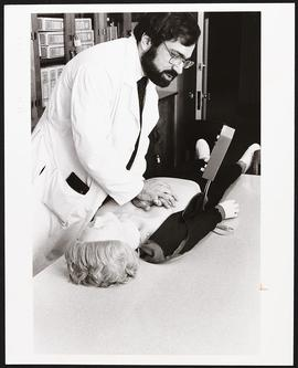 Alan Jaffe demonstrating CPR.