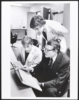 Dr. Philip R. Dodge and two unidentified students, Washington University School of Medicine.