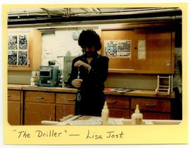 Lisa Jost using a drill in a workshop, Washington University School of Medicine, Program in Occup...