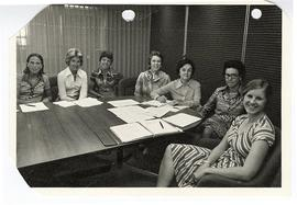Group portrait of the St. Louis Children's Hospital Auxiliary board seated around a conference ta...