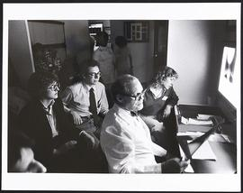 Unidentified doctor with a group of fourth year students, Washington University School of Medicine.