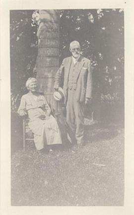 Portrait of Aline and Nathaniel Harrington Cowdry outside by a palm tree.