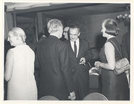 Men and women mingling at a reception for the first Cori Lecture, Roswell Park Cancer Institute, ...