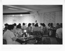 View of nurses eating in a cafeteria with candles on tables, St. Louis Children's Hospital.