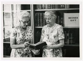 Estelle Brodman and Gertrude L. Annan examining a book from the Becker Rare Book Collection, Wash...