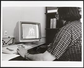 Paul Bethke seated at a computer, Department of Biochemistry, Washington University School of Med...