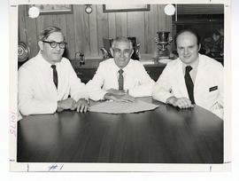 Group portrait of Neil Middlekamp, David Goldring, and James P. Keating seated at a table, St. Lo...