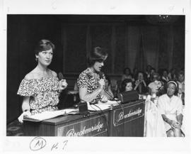Two women standing at podiums, St. Louis Children's Hospital Auxiliary Annual Fashion Show and Lu...