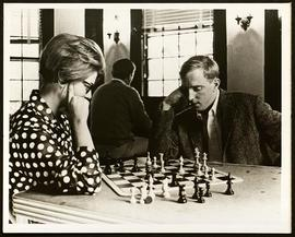 Man and woman playing chess.