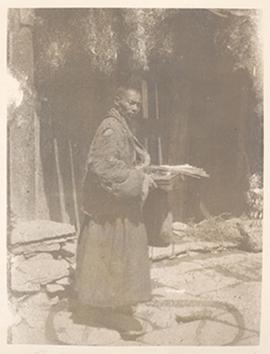 Portrait of a man standing in a courtyard, China.