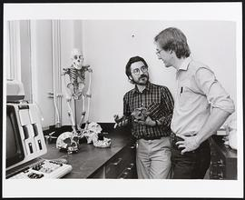 Dr. Glenn Conroy and an unidentified student, Division of Biology and Biomedical Sciences, Washin...