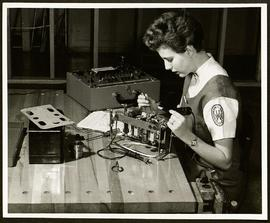Washington University Occupational Therapy student soldering metal.