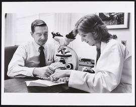 Dr. Robert McDivitt with fourth year student Theresa Vicroy, Department of Pathology, Washington ...