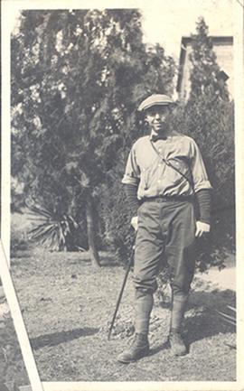 Portrait of Paul H. Stevenson dressed for hiking and leaning on a cane, China.