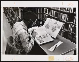 Unidentified student studying in the library.