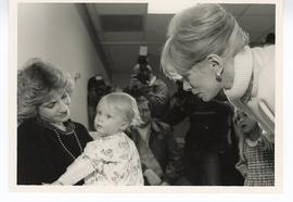 Joan Rivers visiting with an infant patient and her mother, St. Louis Children's Hospital.