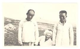 Group portrait of Aline Cowdry and two men, China.