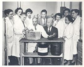 Valentina Suntzeff performing a demonstration with white mice for Chancellor P. Yong-Kan Koh and ...