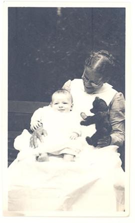 infant, possibly Alice Moira Cowdry, in the lap of Aline Cowdry.