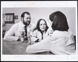 Dr. James Fuller and an unidentified staff member interacting with a patient, Irene Walter Johnso...