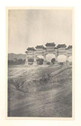 Monumental pillared gates in the countryside, China.