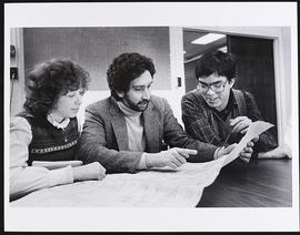 Dr. Michael Miller and two unidentified staff from the Department of Biostatistics, Biomedical Co...