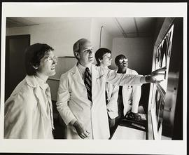 Dr. Samuel Wells with third year students Joseph Francis, Carl Bigler, and Cheryl D. Wright, Depa...