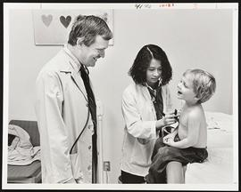 Unidentified doctor and student examining a patient, Department of Pediatrics, Washington Univers...