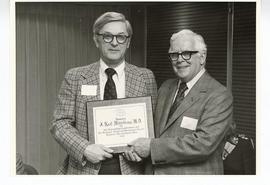 C. Alvin Tolin presenting a plaque to J. Neal Middelkamp, St. Louis Children's Hospital.