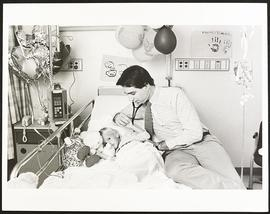 Third year student John Frattini with a patient, Washington University School of Medicine.