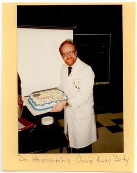 Dr. Herscovitch posing with a cake at his farewell party, Washington University School of Medicin...