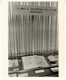 View of an exhibit case containing highlights from the Max A. Goldstein rare book collection, Was...