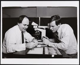 Dr. Daniel McKeel with second year student William Filmyer, Department of Pathology, Washington U...