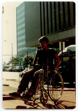 Woman riding a wheelchair up a ramp, Washington University School of Medicine, Program in Occupat...