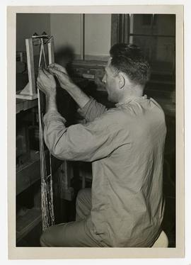 Patient weaving a lanyard by hand, Wakeman General and Convalescent Hospital, Camp Atterbury, Ind...