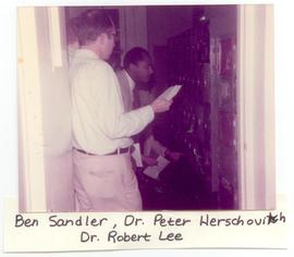 Ben Sandler, Peter Herschovitch, and Robert Lee judging locker paintings at a Washington Universi...