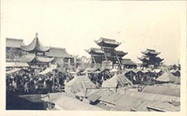 View of a crowded marketplace with tent roofs and pagodas, China.