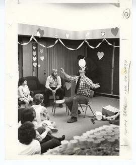4th year medical student Charles Gluck entertaining patients at a Valentine's Day party by balanc...