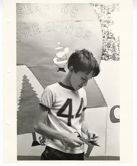 Adolescent boy making Christmas decorations, St. Louis Children's Hospital.
