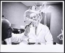 Harry Huth and Dr. Mickey Salmon displaying a glass model showing common sites of cerebral vascul...
