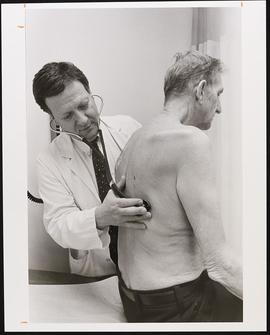 Peter G. Tuteur examining a patient.
