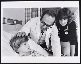 Dr. Richard Hillman visiting a patient with fourth year student Beth Hingsbergen, Department of P...