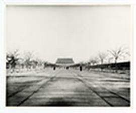 Wide pedestrian avenue leading toward a gate to the Forbidden City, Beijing, China.
