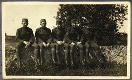 Group portrait of Frederick E. Wendelburg and four unidentified members of Base Hospital 21 seate...
