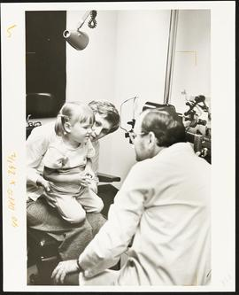 Alan Kolker examining a young patient.