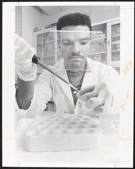 Anibal Melo-Frazier in a laboratory, Department of Biochemistry, Washington University School of ...
