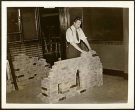 Patient laying bricks.
