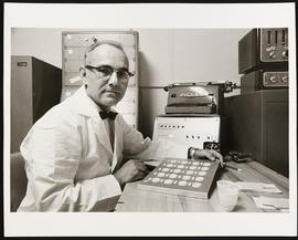 Portrait of Harold Rosenthal in a laboratory setting.