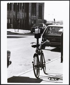 Bicycle leaned against a parking meter, Washington University School of Medicine.