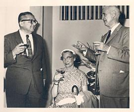 Unidentified man speaking with Alice and E.V. Cowdry at a cocktail party.
